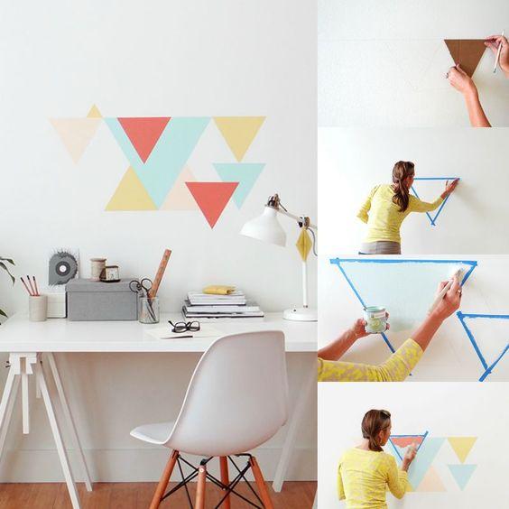 Pinturas de paredes diferentes - Parede com triângulos pintados. Mulher pintando triângulos criativos na parede.