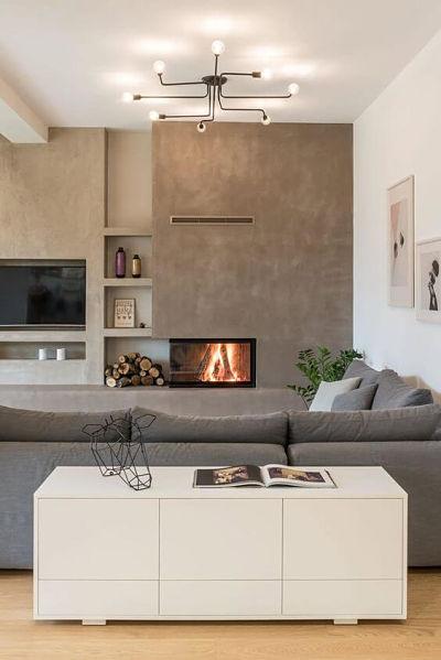 Cimento queimado em sala com sofá cinza