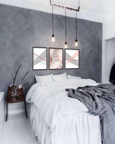 Cimento queimado no quarto com luminária suspensa e quadros