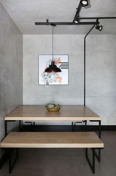 Sala de jantar com cimento queimado