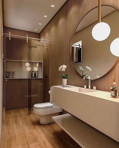 Banheiro com cuba esculpida e espelho redondo