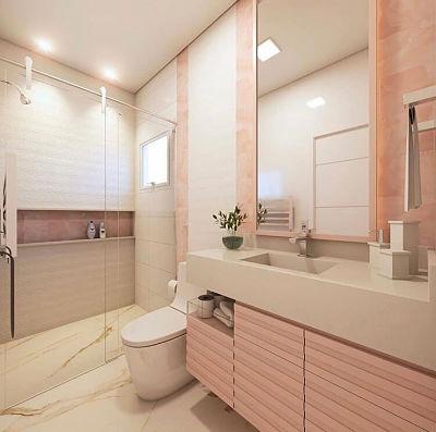 Banheiro rosa com cuba esculpida