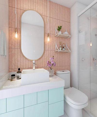 Projeto de Banheiro com azulejo rosa , balcão verde e luminária pendente.