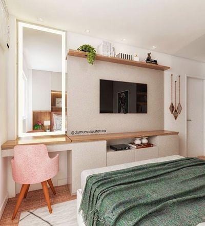 Penteadeira planejada no quarto com espelho e tv