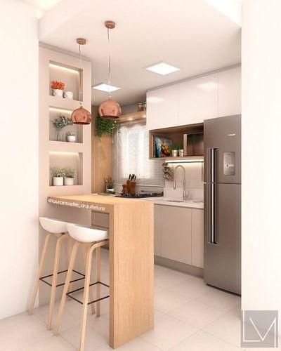 cozinha americana com banqueta alta e luminária pendente