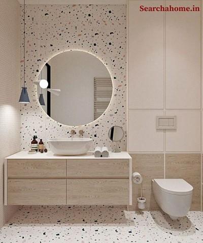 Banheiro com piso granilite e espelho redondo