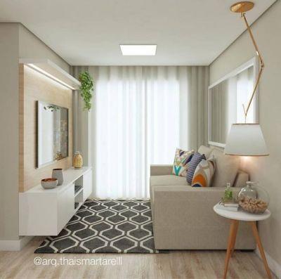 Decoração de Sala pequena com tapete e painel de tv