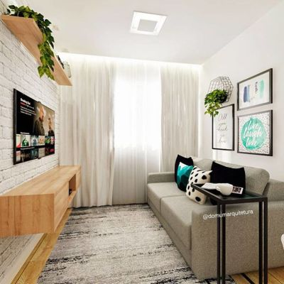 Sala pequena com sofá cinza e rack suspenso