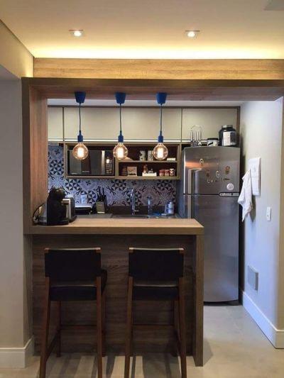Cozinha americana simples com banquetas