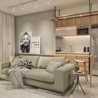 sala pequena com sofá cinza e quadros