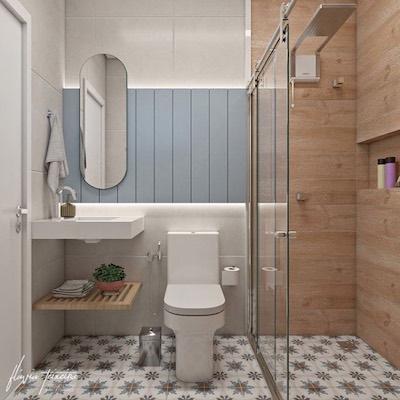 Banheiro pequeno de apartamento  com revestimento que imita madeira e ladrilho hidráulico