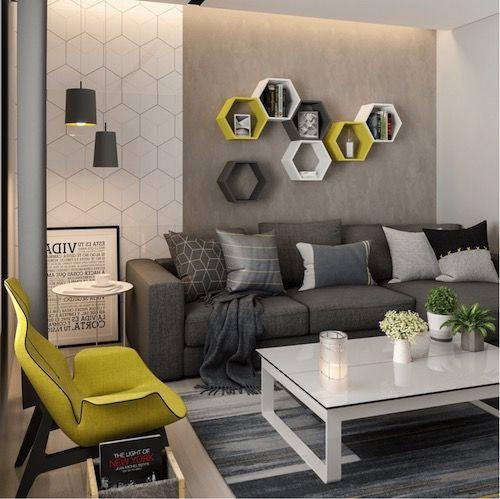 Sala de apartamento pequeno com sofá preto e mesa de centro