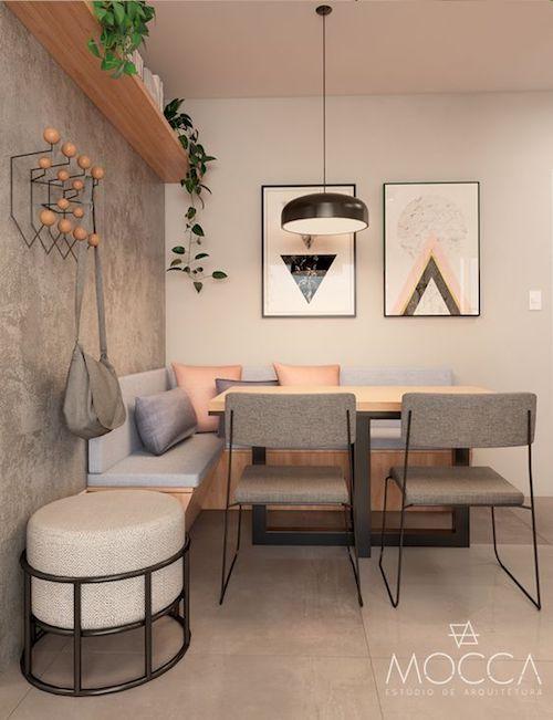Sala de jantar pequena com canto alemão e cimento queimado