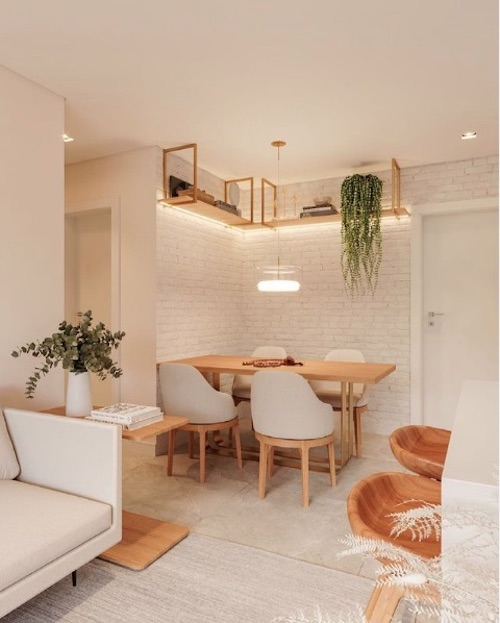Sala de jantar pequena moderna com parede de tijolinho