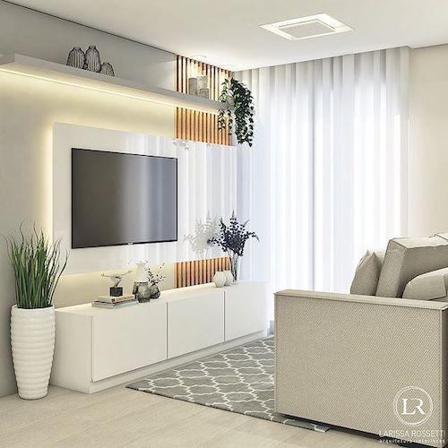 Decoração de sala com rack branco e planta