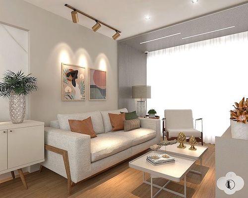 Decoração de sala pequena com sofá e mesa de centro e trilho de luz