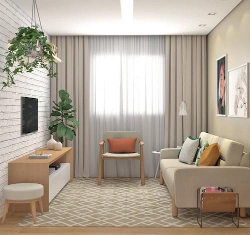 Sala pequena com sofá, poltrona, rack, tapete e plantas