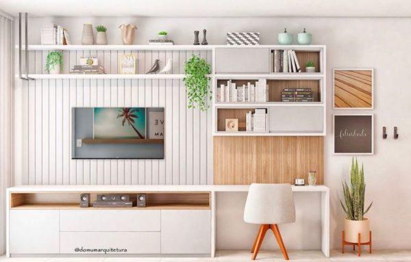 Home office na sala com móveis planejados
